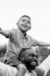 Happy dad with son on his shoulders